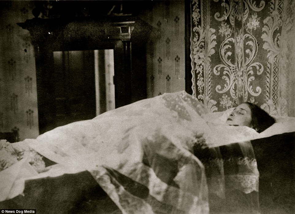 Known as post-mortem photography, some of the dearly departed were photographed in their coffin. This particular style, often accompanied by funeral attendees, was common in Europe but less so in the United States. A woman is pictured here in a coffin in her home in 1905