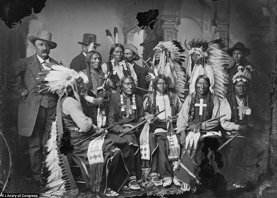 A delegation of visiting Sioux and Arapaho, including Red Cloud, seated at left, and Little Big Man, standing at Red Cloud