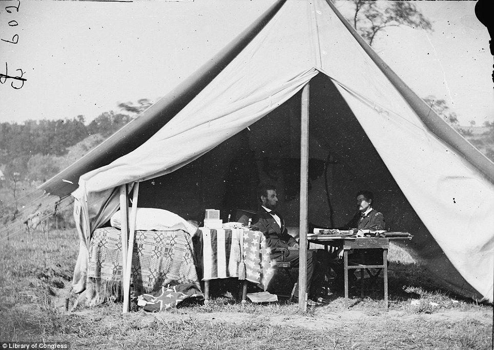 Abraham Lincoln, left, sits in his tent with one of his generals during the Civil War